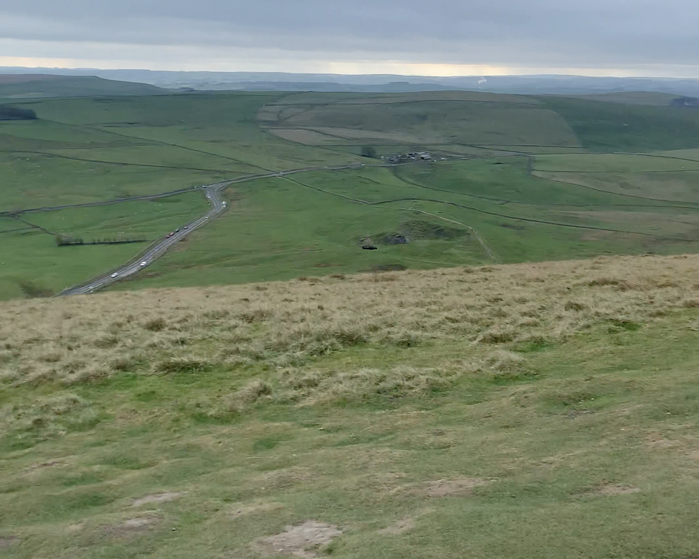 The from the top of Mam Tor showing hills and roads in the distance
